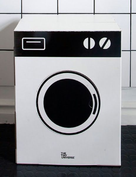 the tiny universe washing/stove. It's a washing machine.. Then turn upside down and it's a stove. Cardboard.