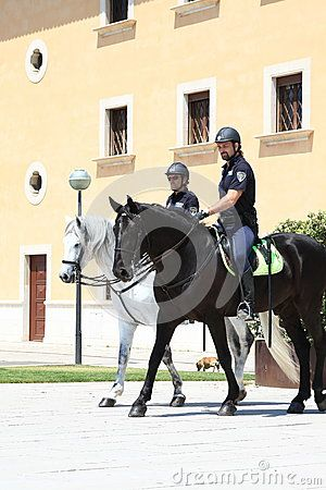 The mounted police patrol on the street in Palma de Mallorca. Mallorca, Spain