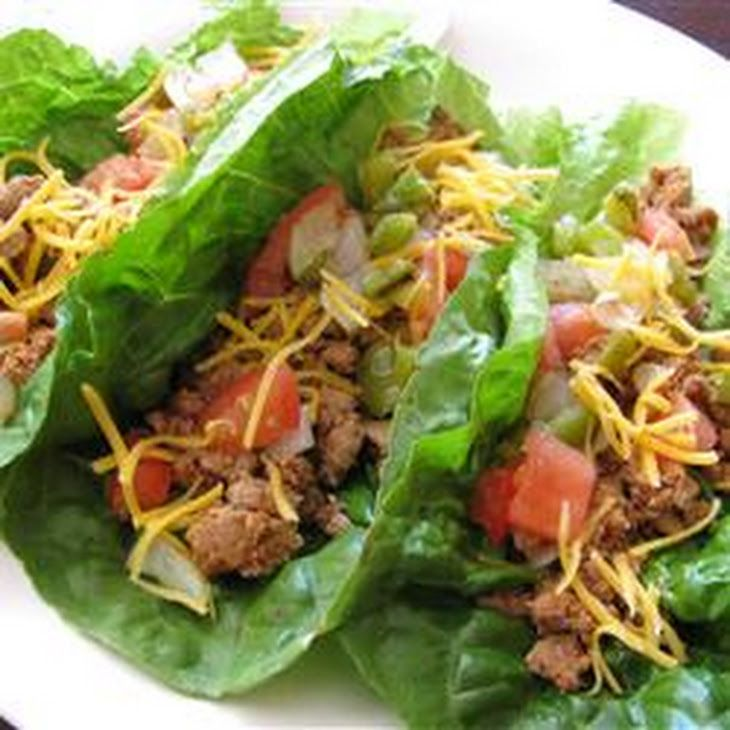 Lettuce Leaf Tacos Recipe Main Dishes with green bell pepper, yellow onion, olive oil, chicken stock, ground beef, taco seasoning, plum tomatoes, salt, shredded cheddar cheese, leav lettuc romain