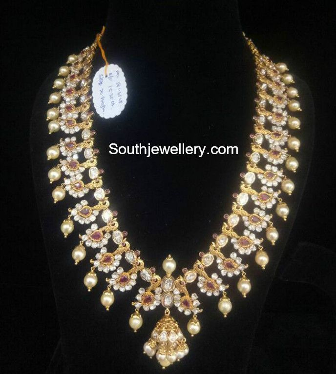 22 carat gold antique finish peacock pacchi mango mala adorned with cz stones, rubies and south sea pearls by Bhavani Jewellers.For price and weight inquiries whatsapp: 9908194122 gold haram latest models, pacchi mango mala, mango mala designs 2018