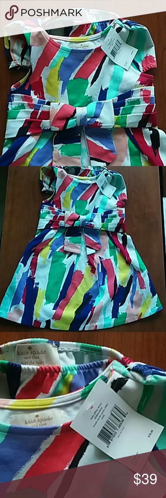 New Kate Spade Jillian Skirt the Rules Dress Set Brand NWT adorable little Jillian Skirt the Rules dress set by Kate Spade. Has a fun and bright paint stroke style print in pinks, blues, red, green, purple, and black on a white background with a bow on the waist. There is a tiny discoloration on one of the yellow areas (pictured) but I didn't see anything else. Super cute!  I ship the next business day. Bundle and save! kate spade Matching Sets