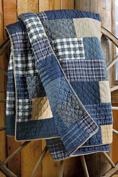 Use the boys' old jeans, shirts, and pjs to make a weathered quilt like this.: