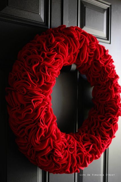 One of the nicer versions of a fabric wreath we've seen:  This red ruffle felt door decoration comes via LifeOnVirginiaStreet.com