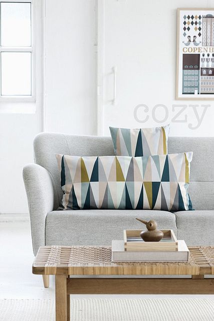 Ferm Living oozes Scandinavian chic with eye catching geometric designs in a soft palette; perfect for enhancing the neutral Scandi backdrop.