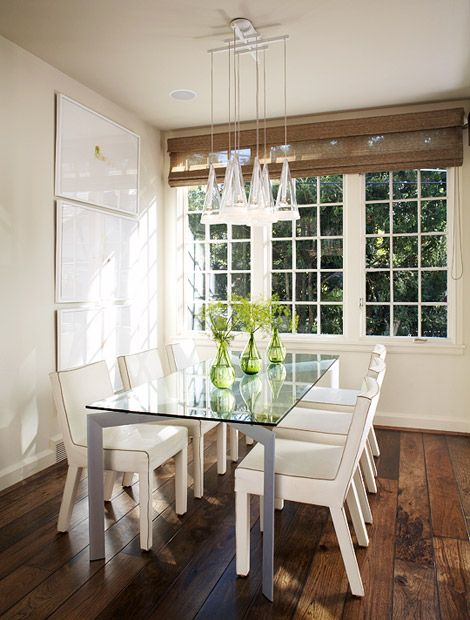 Clear glass table and sleek white leather chairs. Simple and sophisticated.