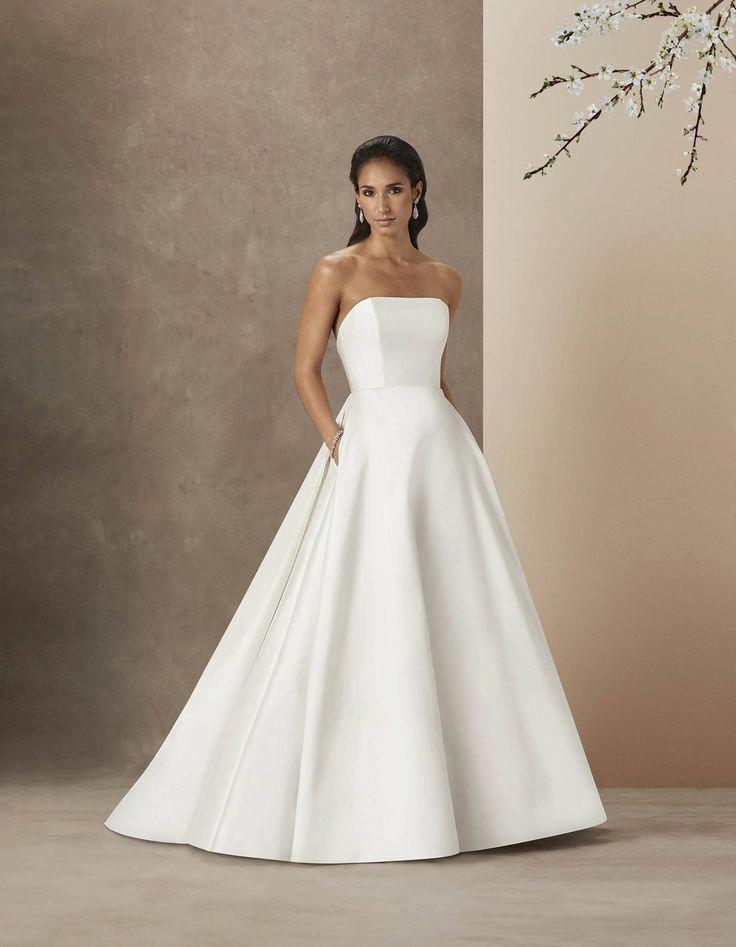 Simple And Plain Wedding Dresses Brides Magazine Minimalist Wedding Dresses Plain Wedding Dress Elegant Wedding Dress
