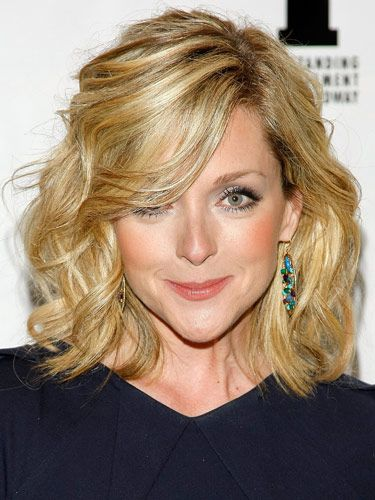 """Women's Day, 2012 """"Find the arch of your eyebrow to start your part,"""" suggests Ungaro. Then, run a volumizer through your hair and blow-dry completely. After your hair's dry, take a 1 ¼-in to 2-in curling iron and set your hair away from your face. Finally, use a sculpting paste and scrunch the curls for texture and control."""""""