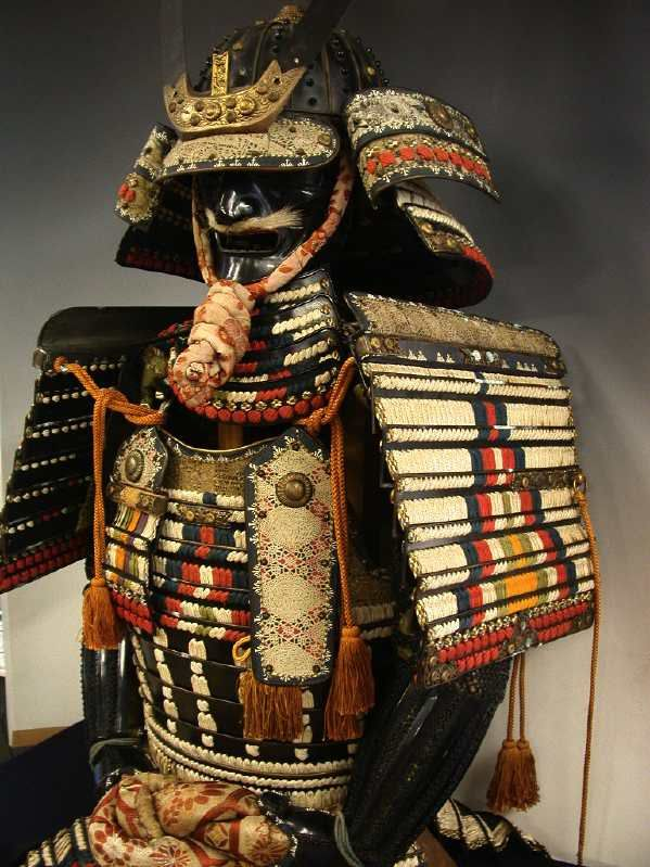 Japanese armor.  As Japanese history progressed, the armor went from crazy complicated and ornate like this example, to very simple and unadorned.  The armor got more practical as time went on.