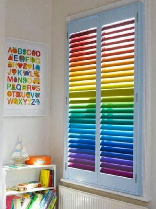 Rainbow blinds in the kids room.