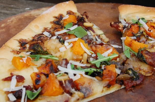 | Butternut Squash Pizza - I used goat cheese, and brushed the dough with chili oil first. Yum yum yum.
