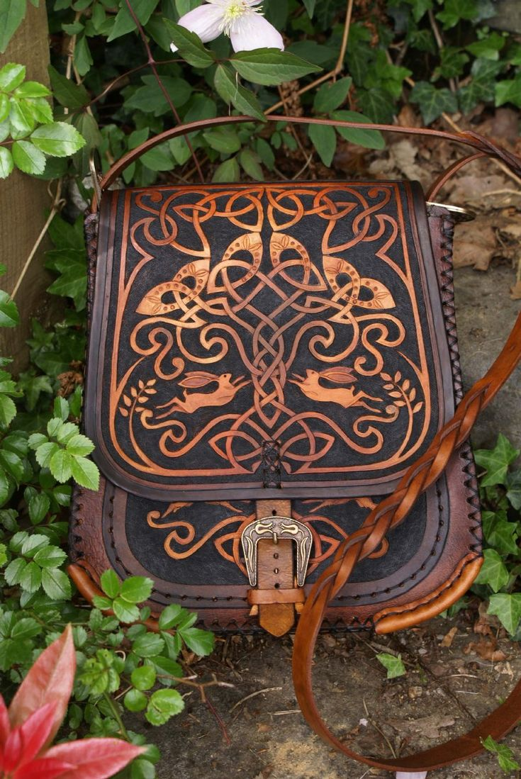 A gorgeous leather carved bag                              …
