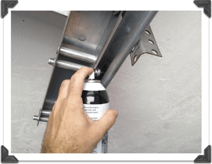 Lubricating Garage Door Roller In 2021 Garage Door Maintenance Garage Door Rollers Garage Door Springs