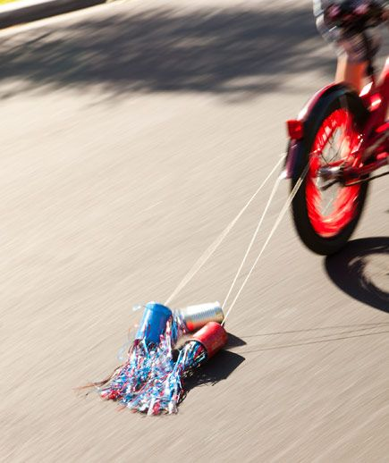DIY FIRECRACKERS... Some firecrackers are meant for the sky; the best ones, however, are made for bikes. (Made w/ tin cans, duct tape & metallic streamers)