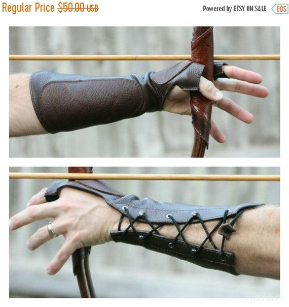 *Ready to Ship*  Protect your arm and hand with this beautiful Woodland deluxe shooting glove and arm guard combination! High quality leather construction with elastic in the fingers and forearm for a one size fits most comfortable fit, whether slim or big. The combination of eyelets and steel speed lacing hooks allows you to quickly put it on over a jacket or on a bare arm with a comfortable elastic shock cord. The cord comes long and can be easily adjusted for a perfect fit by the user…