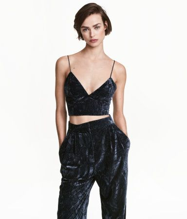 Dark blue. Bustier in crushed velvet with narrow, adjustable shoulder straps and wide elastic at back with a visible zip. Jersey lining.