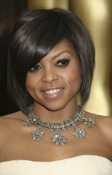 BEST: Taraji P. Henson looked tres sophisticated in 2009, skillfully parting her short hair on the side, and opting for the dark eyes/nude lips look.