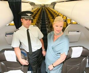 Former Freedom Air pilot Jonathan Powles and flight attendant Sarah-Jane Whitehead bid farewell to the airline onboard an Air NZ A320 with Freedom Air seat headrest covers