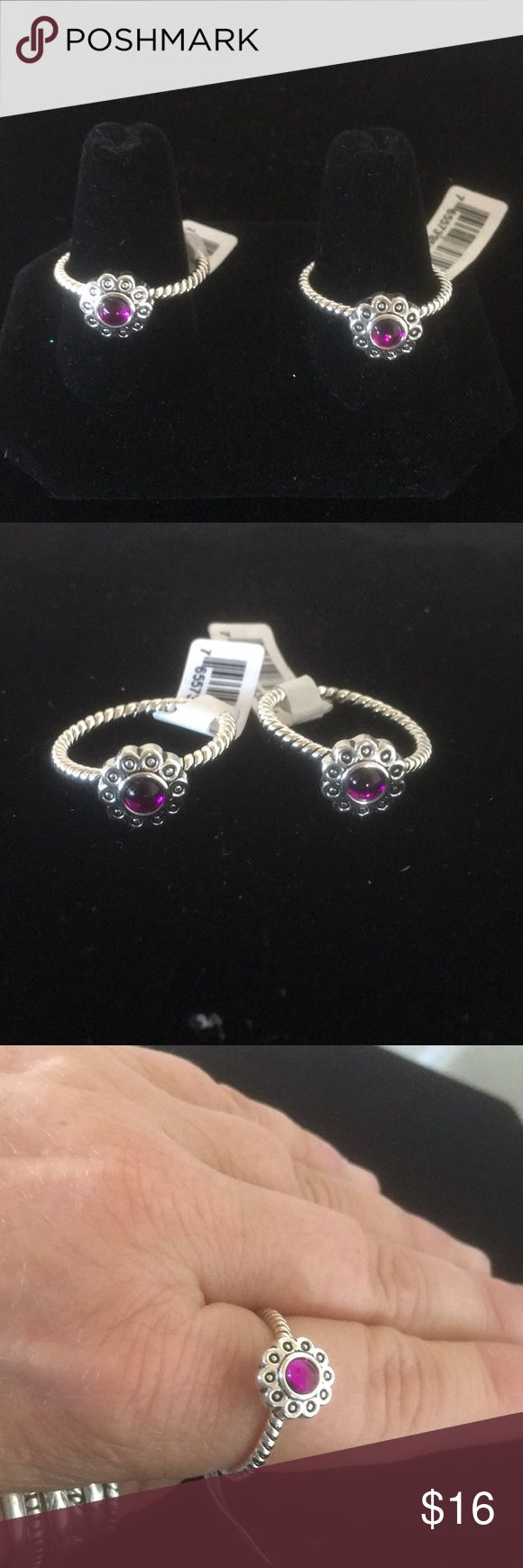 Purple Flower Ring- Size 9 Gorgeous silver plated ring with purple flower. Dainty in its simplicity but beautiful! I have 2 in stock and price reflects the price for 1 ring. Both are Size 9. (Bundles of 2 or more items saves you 10%!) Jewelry Rings