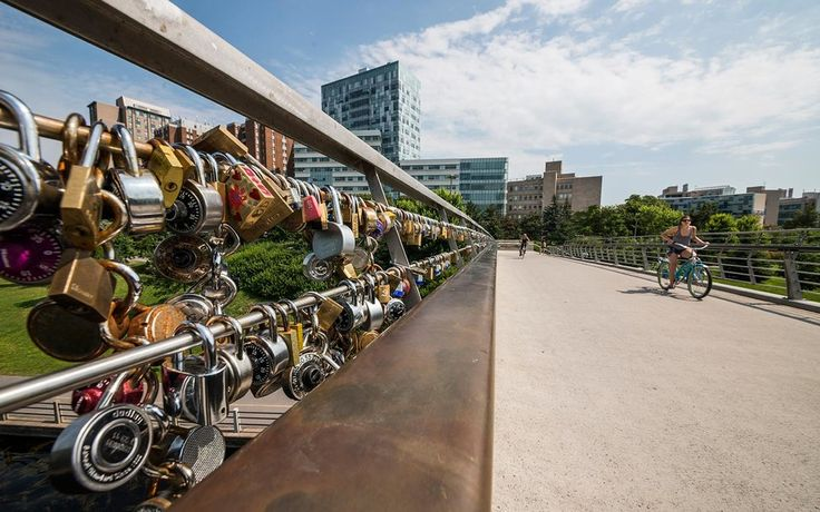The Corktown Bridge in Ottawa is also a romantic destination for lovers to seal their affections with a love lock. The bridge is like a celebration of love. #Canada
