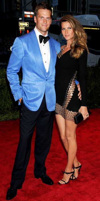 Gisele Bundchen in an Anthony Vacarello dress with husband Tom Brady.