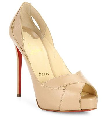 "academa leather pumps by Christian Louboutin. Spliced leather crisscross sandal set on sky-high heel. Self-covered heel 4.75"" (120mm).Leather upper. Peep toe. Leat..."