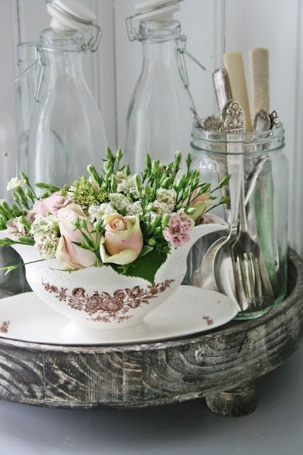 Silver tray, creamer with rosebuds and.... a Mason jar full of pretty silverware.