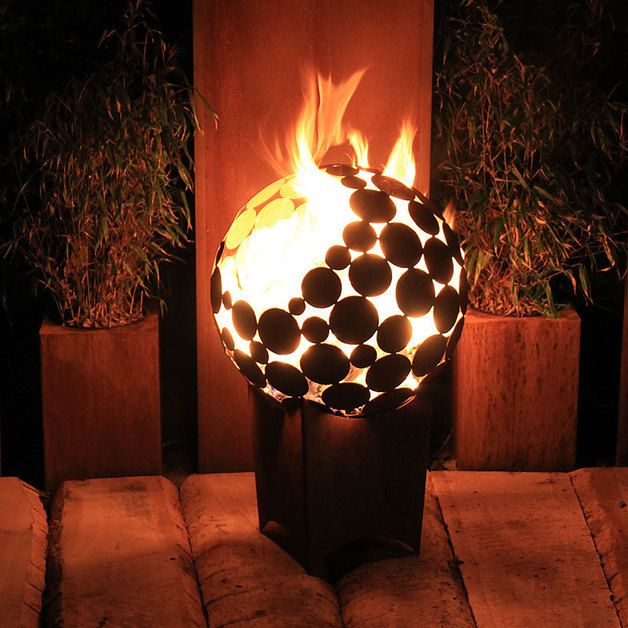 Feuertonne in Kugelform für den Garten / fireplace made of metal sphere as garden decoration made by Atelier51 via DaWanda.com