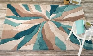 Add a touch of modern style to a contemporary interior with one of these hand carved rugs that come in three sizes