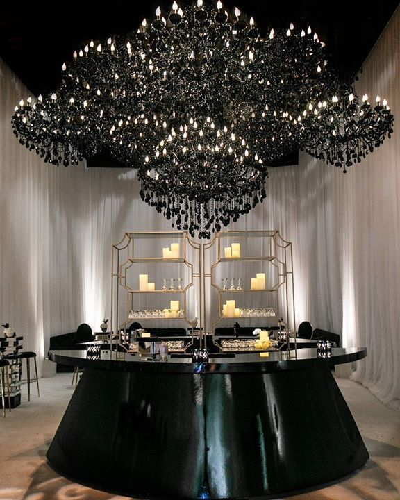 For a unique dramatic look -  black crystal chandeliers hang over a black top hat bar ~  Revelry Event Designers's photo.