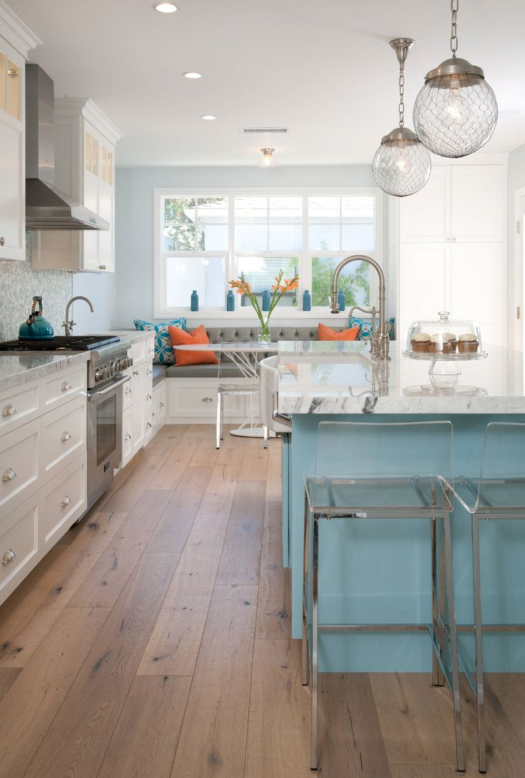 different color island with white top and white cabinets have grey