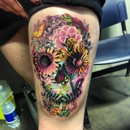 feminine skull tattoo on hip