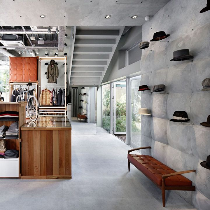 Takeo Kikuchi flagship store by Schemata Architects - concrete upholstered wall, great banquette detail