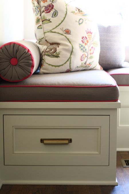 Brilliant idea! A bolster pillow will help keep the pillows from falling into the windows for the bench seats I have planned! :) This before & after project is AMAZING!