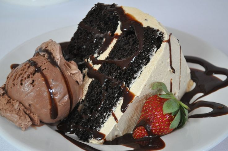 Looking for the ultimate chocolate treat on V-day? Here's an incredibly moist dark chocolate Cake iced with a whipped cappuccino buttercream icing and served with chocolate ice cream drizzled with chocolate syrup…