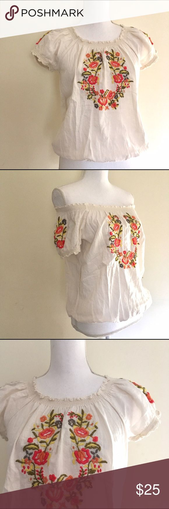 """Style & Co Floral Embroidered Boho Blouse Beautiful Orange and yellow flowers Embroidered onto white/Cream 100% cotton peasant blouse. Stretchy smocked neckline and hemline. In excellent pre-owned condition. Approx. Measurements: 16.5"""" armpit to armpit, 21.5"""" long.      🎀Search my closet for your size to: 🎀BUNDLE and SAVE! 🎀NO TRADES NO HOLDS 🎀Thank you for stopping by!❤️ Style & Co Tops Blouses"""
