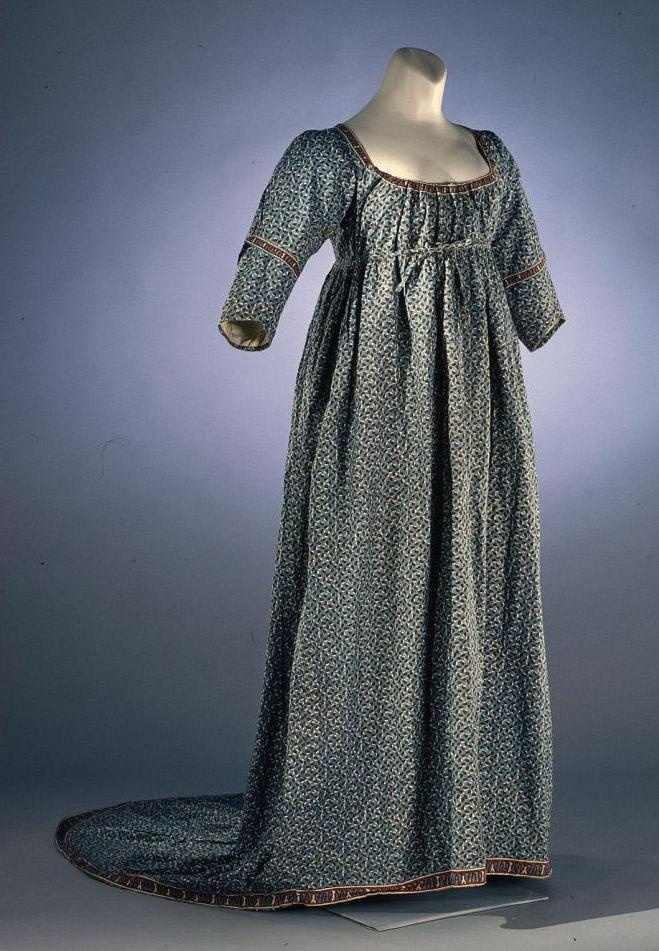 Gown (Round Gown?): ca. 1790-1810, English, cotton block-printed to shape, ties under bodice,  loop and string ties on train to fasten it up, bodice lined with cotton, sleeve extensions are separable. Not shown: B  C. Two matching thumbless mitts or removable long tight sleeves, wrist length, unlined. [Search for Acc. No. 1991-449,A-C]