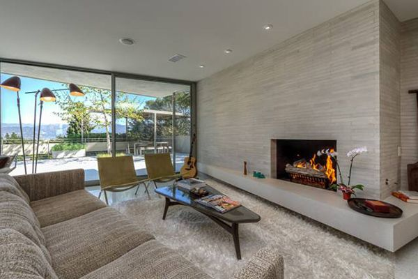 This walled and gated three-bedroom, three bath home, designed by John Bertram is the quintessential mid-century gem.