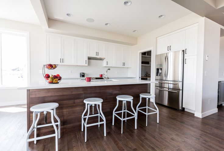 This modern dining room features Lauzon's Sincero Red Oak flooring from our Authentik serie. This extremely durable wood offers rich brown color and distinctive grain. Photo by Lexis Homes for the Rosewood Show Home.