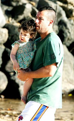 """""""It's just weird that out of nowhere God said, 'May the three best-looking guys in Hollywood have babies - Tom Cruise, Brad Pitt and me,"""" Adam Sandler, 41 - seen here toting daughter Sadie, 1 1/2, in Hawaii shortly before the Christmas holiday - joked."""