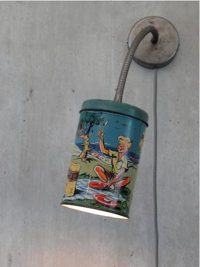 A charming little vintage tin upcycled into a wall light