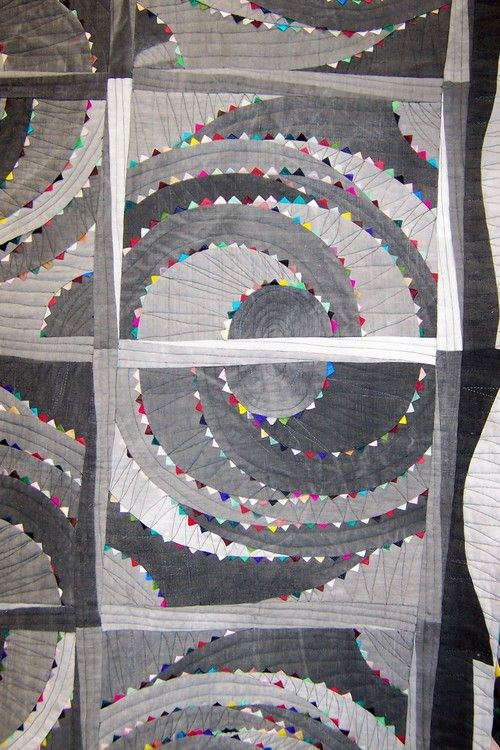 Gray tone spiral quilt detail. Super amazing prairie points stitched in the seams here. I'd love to do something like this!