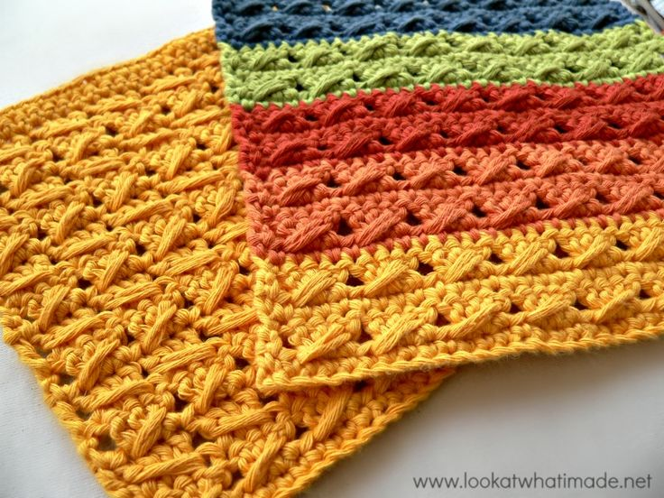 Crochet dishcloths is bright colors using Kitchen Cotton.  Pattern by Look at What I Made.
