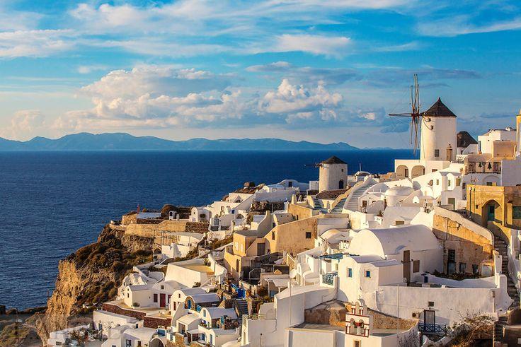 Santorini; Greece; Aegean Sea; Oia town; blue church; sunset