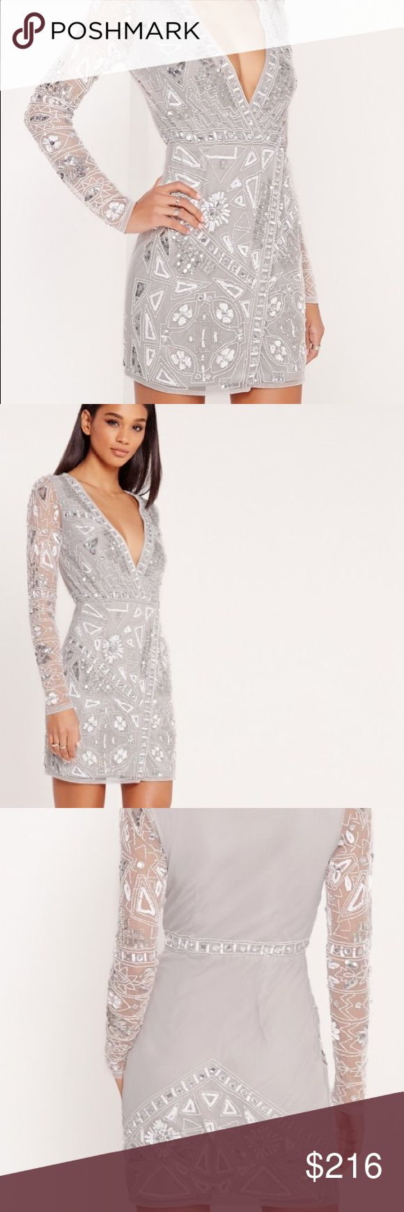 Long sleeve embellished wrap mini dress long sleeve mini dress. with stunning embellished detailing all over and to the back, this mesh overlay beaut is a must for weddings and events. be centre of attention and shine amongst the rest! with hints of grey, silver and white, this wrap over dress comes with a plunging neckline and discrete zip to the side. team up with silver court shoes and a matching clutch and all eyes will be on you! Missguided Dresses Mini