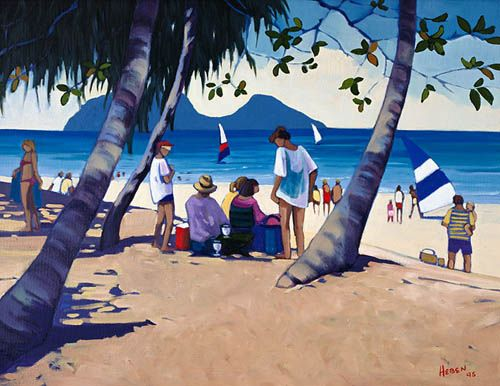 Beach goers enjoy the blue waters of Palm Cove looking across to Double Island