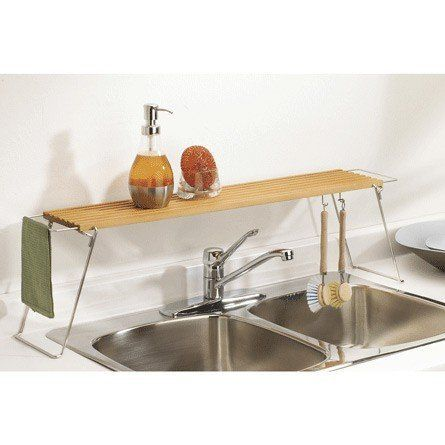 Umbra Overboard Sink Shelf, Natural by Umbra. $34.99. Over-the-sink wooden shelf provides more counter space. Measures 35-1/2 by 6-1/2 by 9-3/4 inches. Wipes clean with a damp cloth; designed by Sativa Turner. Utensil hooks and a rail for hanging a dishcloth to dry. Stainless-steel legs collapse for easy storage. The Umbra Overboard Sink Shelf in Natural is an easy way to gain counter space in your kitchen. This 35-1/2 long by 6-Inches wide shelf stands 10-Inch...