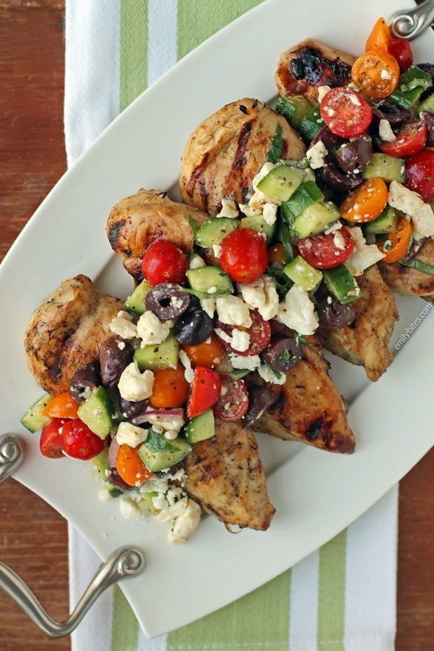 This Mediterranean Topped Grilled Chicken is the perfect low carb, healthy recipe! Super flavorful and just 327 calories or 7 Weight Watchers SmartPoints. www.emilybites.com
