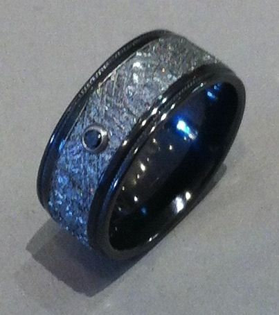 Unique Gibeon Meteorite 8mm wide wedding ring lined in stepped edge Black Zirconium, milgrain detail, with a black diamond. This is how you define awesome.