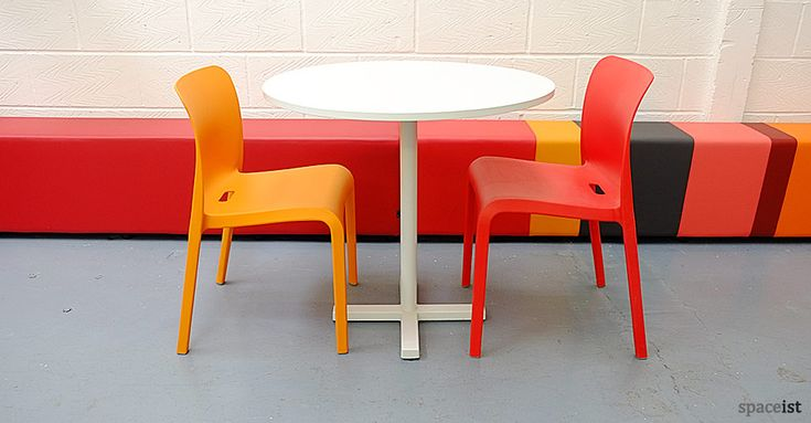 Bold white round modern cafeteria tables.