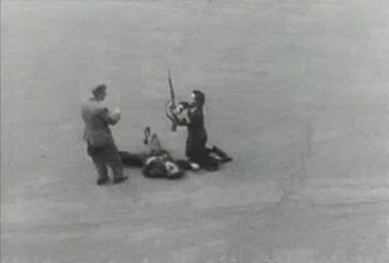 Disarming a dead German during liberation of Paris - Libération de Paris